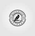 vintage black raven or crow logo design vector image
