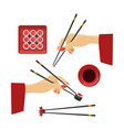 oriental hands with chopsticks vector image