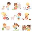 cute little boys and girls feeding animals set vector image vector image
