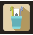 Blue plastic cup with brushes icon flat style vector image