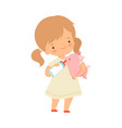 cute little girl feeding piglet with bottle of vector image vector image
