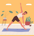 man standing in triangle pose practicing yoga vector image vector image