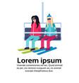 women couple skiers on chairlift ski resort vector image