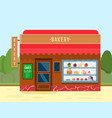bakery shop building with sweet desserts banner vector image vector image