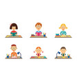 flat kids studying at desks set vector image vector image