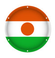 round metallic flag of niger with screw holes vector image