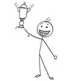 stick man cartoon of happy man holding a trophy vector image