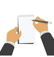 hand holding notebook and pencil vector image