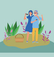 couple with smartphones basket picnic meadow vector image