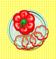 red sweet pepper on a plate with slices vector image vector image