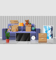 sofa with cardboard boxes with household items vector image vector image