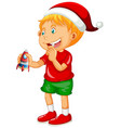 cute boy wearing christmas hat and playing with vector image