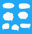 white blank retro speech bubbles set on blue vector image