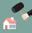 Business man handle a hammer to destroy a house vector image