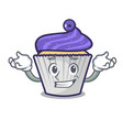 grinning blueberry cupcake character cartoon vector image