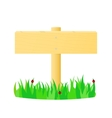 Wooden pointer in the green grass vector image