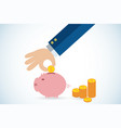 hand putting coin in piggy bank vector image vector image