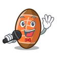 singing rugby ball mascot cartoon vector image vector image
