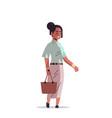 beautiful indian woman holding handbag smiling vector image
