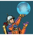 Retro astronaut is holding the planet Earth on vector image vector image