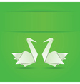 Origami swans on green background vector image
