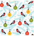 seamless pattern with bullfinch on a spruce branch vector image