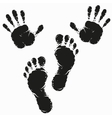 Black footprint and hand print vector image vector image