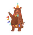 cute teddy bear wearing party cap and holding vector image vector image