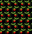 Red strawberries with green leaves on a black vector image