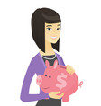 Asian business woman holding a piggy bank vector image
