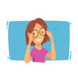smiling girl trying on glasses ophthalmology vector image