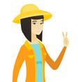 young asian farmer showing the victory gesture vector image vector image