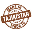 made in tajikistan brown grunge round stamp vector image vector image
