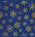 golden and nay blue snowflakes seamless vector image