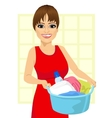 woman holding a laundry basket vector image