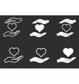 Heart in hand icon set vector image
