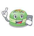 with phone pistachios cake in saucer cartoon vector image