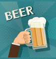 human hand holds a mug of beer vector image