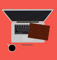laptop and office supplies laying on the board vector image vector image