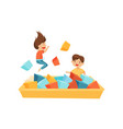 little boy and girl playing in pool with soft vector image