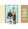 man getting a shave from male barber at salon vector image