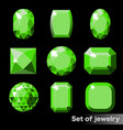 set of green gems emerald of various shapes vector image