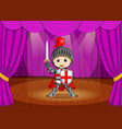 cute little boy wearing knight costume on stage vector image vector image