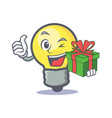 Light bulb character cartoon with gift