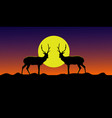 silhouette of two deer standing on a mountain vector image