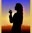 girl smokes at sunset vector image vector image