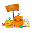 halloween pumpkins with wooden board sweets and vector image vector image