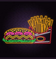 retro neon hot dog and french fries sign on brick vector image vector image