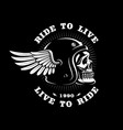 biker skull in helmet with wing on dark background vector image vector image