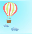 a balloon flying in the clouds across the sky vector image